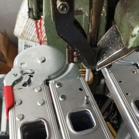 Multi-purpose ladder hinges rivet machine